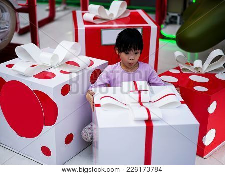 Happy Xmas And New Year Holiday! Shocked And Surprised Kid. Cheerful Smiling Little Girl Opens Her M