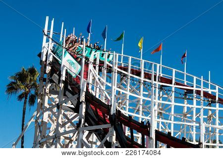 San Diego, California - February 9, 2018:  People Ride The Giant Dipper Roller Coaster, Built In 192