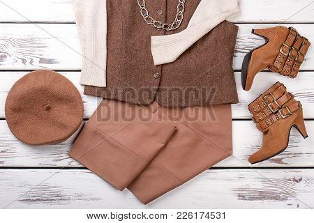 Beautiful Combination Of Female Fashion Outfit. Flat Lay Women Stylish Apparel On White Wooden Backg