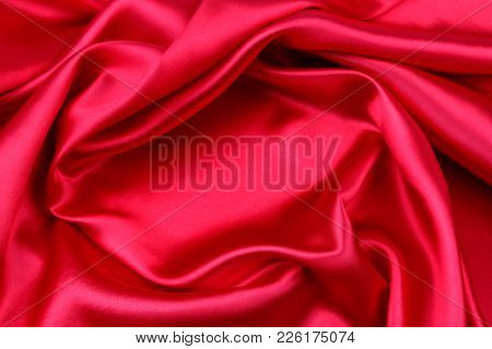 Closeup of ripples in red silk fabric