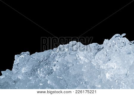 Pile Of Crushed Ice Cubes On Dark Background With Copy Space. Crushed Ice Cubes Foreground For Bever