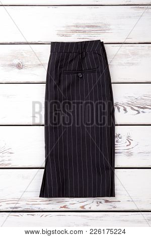 Female Black Skirt With White Stripes. Women Classic Pencil Skirt On White Wooden Background. Ladies