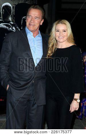 LOS ANGELES - FEB 5:  Arnold Schwarzenegger, Heather Milligan at the