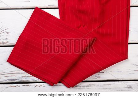 Women Red Striped Classic Trousers. Female Business Style Apparel On Wooden Background. Feminine For