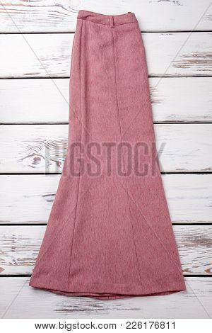 Long Vintage Skirt, Top View. Female Skirt Of Pink Color, White Wooden Background. Women Classic App
