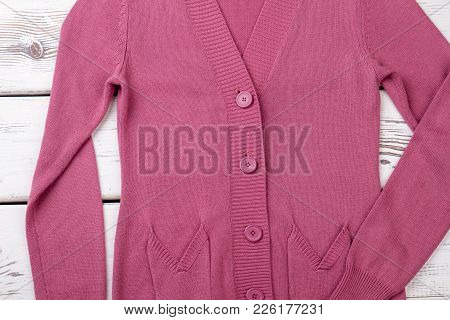 Female Pink Cardigan With Buttons. Women Sweater With Pockets On Wooden Background. Female High Qual