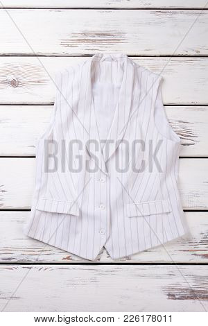 Female Elegant Waistcoat, Top View. Women Formal Style Clothes On Wooden Background.