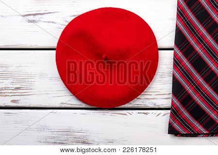 Female Red Beret, Top View. Women Autumn Clothes And Accessories, White Wooden Background. Female Cl