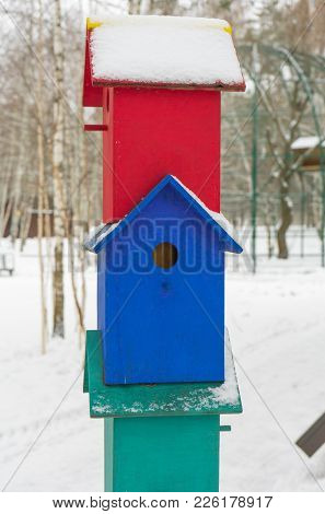 Colorful Birdhouses For The Birds In Snow.