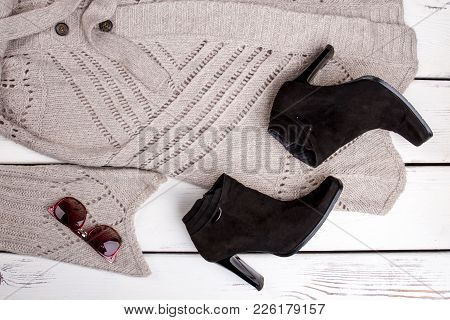 Set Of Female Fashionable Clothes. Women Gray Cardigan, Black Ankle Boots And Sunglasses. Feminine T