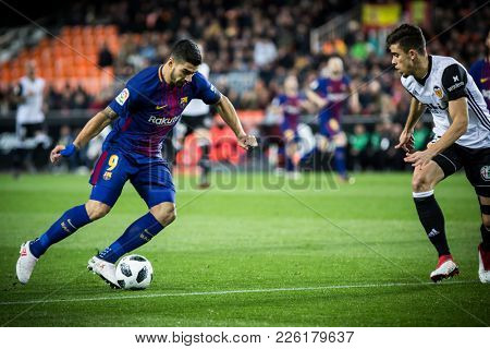 VALENCIA, SPAIN - FEBRUARY 8: Luis Suarez with ball during Spanish King Cup match between Valencia CF and FC Barcelona at Mestalla Stadium on February 8, 2018 in Valencia, Spain