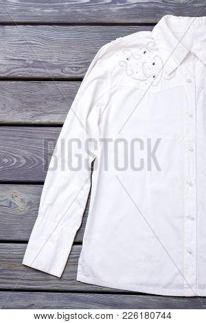 Female Elegant White Cotton Shirt. Women Classy Apparel On Wooden Background. Feminine Beautiful Att