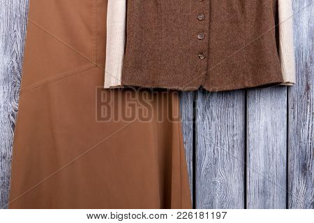 Female Clothes On Wooden Background. Women Waistcoat And Sweater. Feminine Classy Outfit.