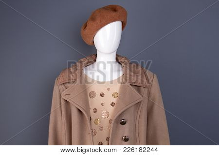Female Mannequin In Top Coat And Beret. Feminine Casual Autumn Apparel. Women Fashion And Style.