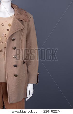 Female Mannequin In Overcoat, Copy Space. Modern Cashmere Buttoned Jacket For Women, Grey Background