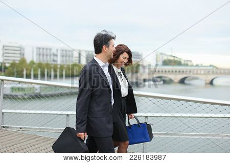 Economists Walk During Lunch Break, Married American Middle-aged Couple Going To Have Snack. Man And