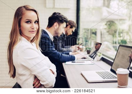 Business Woman Working With Business Team By Laptop Computer. Beauty And Technology Concept. Smart L
