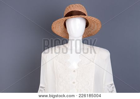 Fashionable Straw Hat With Ribbon. Female Mannequin In Modern Headgear And Lace Blouse, Grey Backgro