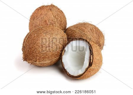 Three Whole Coconut And Half Isolated On White Background.