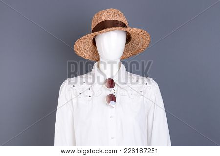 Female Straw Hat And Sunglasses. Feminine Elegant White Shirt On Mannequin. Boutique Of Feminine Gar
