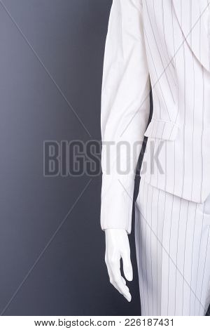 Female Mannequin In White Striped Suit. Women White Color Waistcoat And Trousers, Copy Space. Ladies