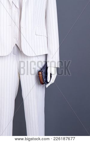 Mannequin In White Formal Suit With Wallet. Ladies Elegant Blazer, Trousers And Stylish Accessory. F