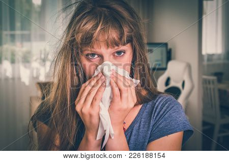 Sick Woman With Flu Or Cold Sneezing Into Handkerchief At Home - Retro Style