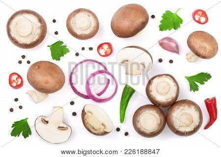 Fresh Champignon Mushrooms With Parsley, Peppercorns And Red Hot Chili Peppers Isolated On White Bac