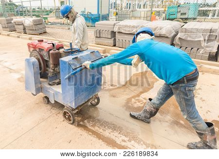 Labor Construction Worker Using Machine Cutter Joint Concrete Road Slab
