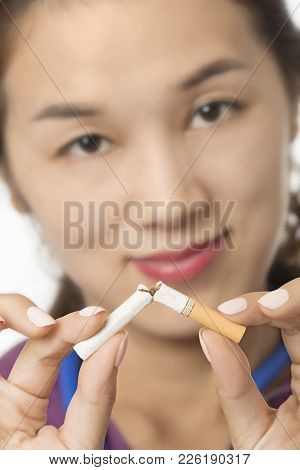 Asian Doctor Or Nurse Holding A Broken Cigarette To Illuminate The Concept Of Quit Smoking Isolated