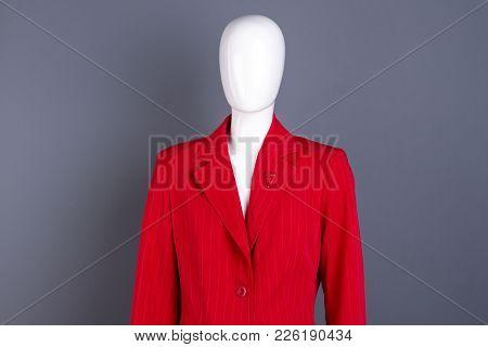 Mannequin Dressed In Red Striped Blazer. Women Red Formal Jacket On Mannequin, Grey Background.