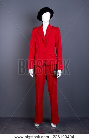 Full Length Mannequin In Female Red Suit. Female Black Hat And Red Formal Style Suit On Mannequin. W