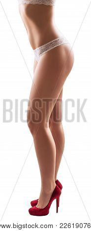 Beautiful Sexy Woman Stands On High Heels, Isolated On White Background