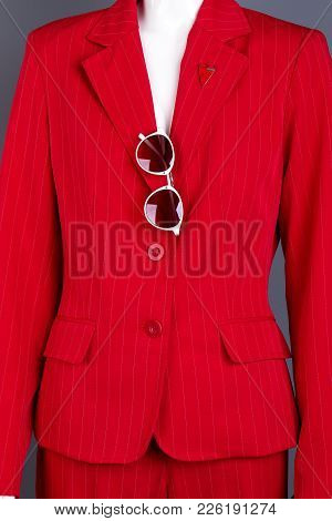Close Up Red Women Blazer With Sunglasses. Female Mannequin Dressed In Red Formal Suit With Sunglass