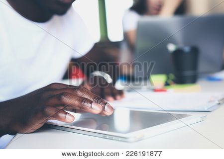 Close-up Hand Using Tablet, Selective Focus Finger Touching On Tablet Display