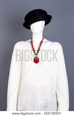 White Knitted Sweater And Necklace. Female Mannequin Dressed In Black Hat And White Pullover. Ladies