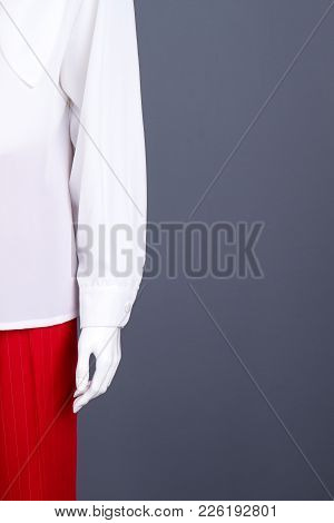 Female Mannequin In Elegant Clothing, Copy Space. White Blouse And Red Trousers, Cropped Image. Fema