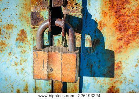 Old Metal Barn Castle On Rusty Iron Door. Access Closed