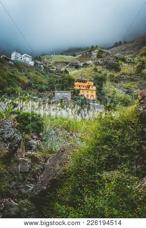 Local Dwellings Built On The Mountain Cliffs, Surrounded By Cultivated Vegetation. Paul Valley. Cult