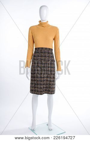 Female Yellow Sweater And Checkered Skirt. Female Mannequin In Pullover And Skirt Isolated On White