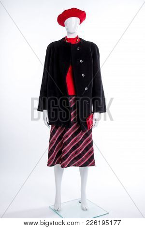 Red Beret And Black Coat For Women. Female Mannequin Dressed In Black Top Coat And Skirt, Isolated O
