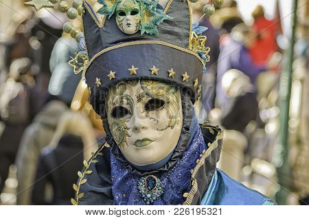 Portrait Of A Beautiful Woman Dressed As A Blue Wizard During The Venetian Carnival Party In San Mar