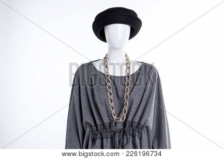 Black Hat, Grey Blouse And Chain. Female Mannequin With Elegant Tunic, Hat And Jewelry, White Backgr