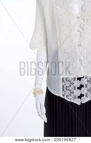 Close Up Mannequin In Elegant Female Clothing. White Silk Blouse And Black Skirt, Copy Space. Pearl