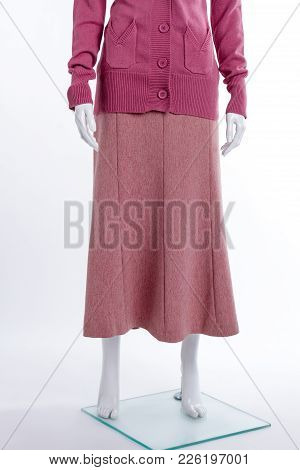 Sweater And Skirt, Cropped Image. Female Mannequin Dressed In Pink Classic Skirt, White Background.