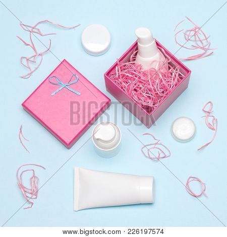 Cosmetics As Present For Girl. Gift Box And Different Beauty Products. Gift Wrapping