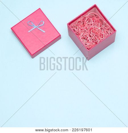 Close-up Of Open Pink Gift Box Filled With Decorative Shavings, Free Space For Text. Preparation For