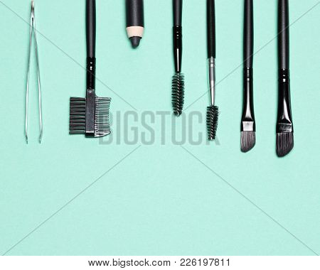 Accessories For Care Of Brows On Turquoise Background. Eyebrow Grooming Tools. Free Space For Text