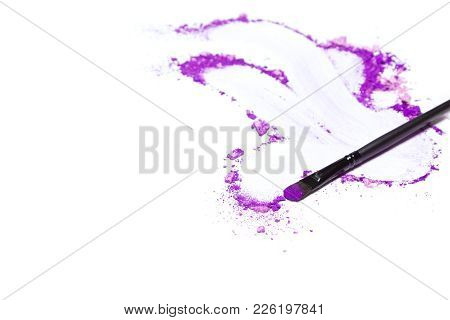 Make-up Brush And Crumbled Mixed Ultra Violet Eye Shadow Different Shades On White With Space For Te