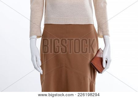 Close Up Brown Skirt And Wallet. Female Mannequin With Sweater, Skirt And Purse Close Up, Cropped Im